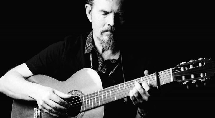 Keith James playing the guitar