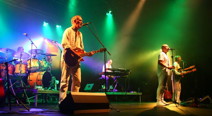 G2 Genesis band performing on stage