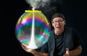 The Amazing Bubble Man holding a bubble up