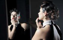 Viviana Zarbo looking into a mirror